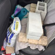 This was my car Saturday morning. I bought a fraction of stone that I would need because I just wanted to try it out before really committing. If for some reason, it ended up being a disaster, I really didn't want all that stone!