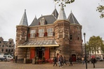 """The Waag (""""weigh house"""") is a 15th-century building on Nieuwmarkt square. It was originally a city gate and part of the walls of Amsterdam. The building has also served as a guildhall, museum, fire station and anatomical theatre, among others. The Waag is the oldest remaining non-religious building in Amsterdam.[1] The building has held rijksmonument status since 1970.[2] The Waag is depicted in Rembrandt's 1632 painting The Anatomy Lesson of Dr. Nicolaes Tulp. The surgeons' guild commissioned this painting for their guildhall in the Waag."""