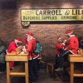 "Lots of drunk ""Santas"" apparently participating in a bar crawl"