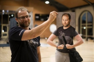 Tom here, who is Amanda 'Butler' Pitts' husband kindly modeled at the conference last week when we needed to check the lighting setup and printing capabilities. Once we had the print, I twisted his arm to humor me while I posed behind his headshot. Photo by Misty McElroy
