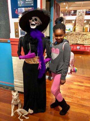 Posing with a Dia de los Muertos display