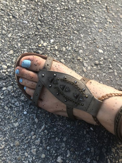 Shannon's splattered foot from the black tempra paint we put down as a base.