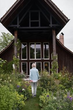 Reeli in her garden outside her home